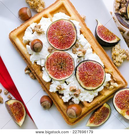 Vienna Wafer Dessert With Ricotta, Nuts And Fresh Figs On White Plate Over Wooden Background, Square