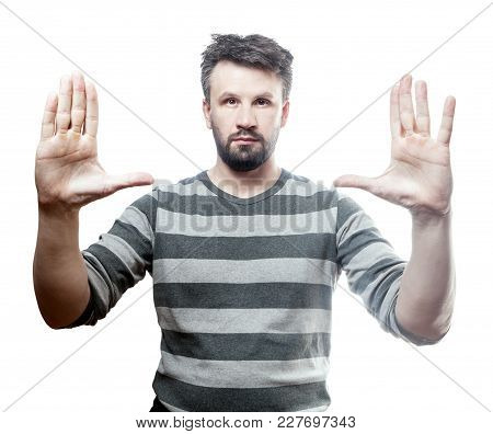 Magic Trick. Photo Portrait Of A Young European Man Showing Both Of His Opened Palm. Isolated On Whi