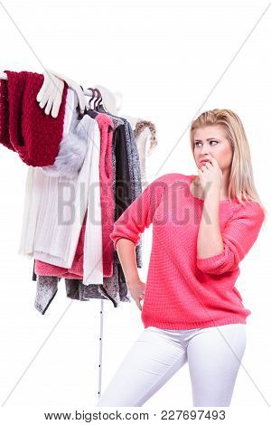 Young Woman Indecision In Wardrobe, Teen Blonde Girl Choosing Her Warm Winter Fashion Outfit In Walk