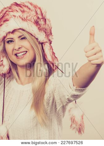 Clothing Accessories, Seasonal Clothes Concept. Woman Wearing Winter Furry Warm Hat Showing Thumb Up