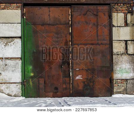 Rusty Garage Door. Grunge Garage Door. Metal Garage Door. Metal Door.