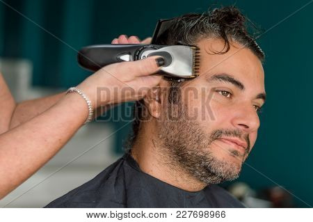 Female Barber Working With Hair Clipper, Shaving Young Man's Face