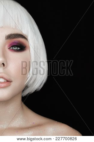 Beautiful Half Face Woman Looks To The Camera Isolated On Black Background