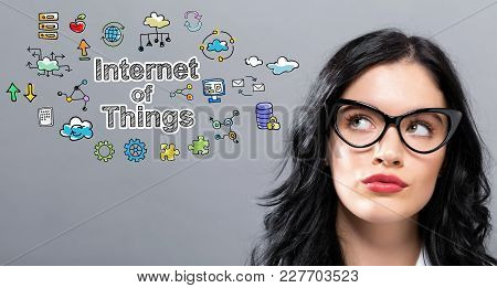 Internet Of Things With Young Businesswoman In A Thoughtful Face