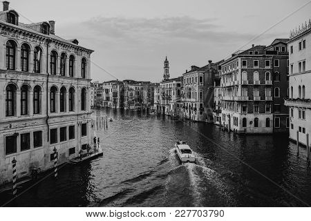 Black And White View Of A Speed Boat Navigating Through Grand Canal And The Buildings From Rialto Br