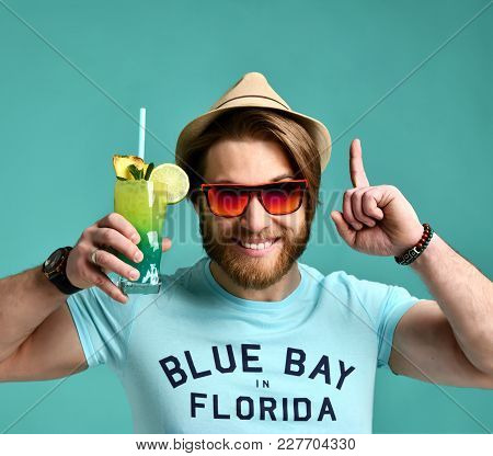 Young Man In Hat And Red Sunglasses Hold Margarita Cocktail Drink Juice Happy Pointing One Finger Up