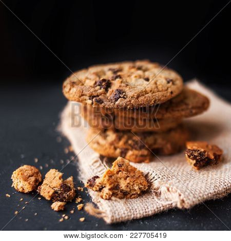 Heap Of Chocolate Chip Cookies On Dark Background  With Place For Text. Choco Cookie On  Linen Napki