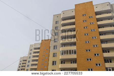 Modern multistory apartment buildings. Contemporary architecture. Residential buildings. Building fragment. Housing estate. Apartment blocks