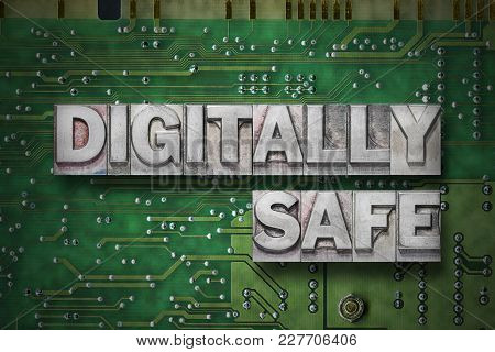 Digitally Safe Phrase Made From Metallic Letterpress Blocks On The Pc Board Background
