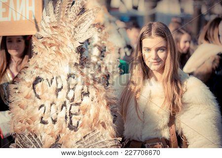 Pernik, Bulgaria - January 26, 2018: Beautiful Teenage Girl Smiling At Camera And Holding Sign Surva