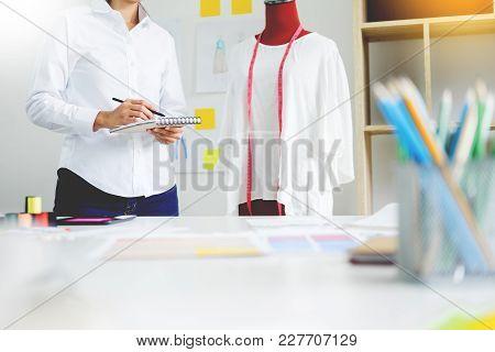 Asian Tailor Adjusts Garment Design On Mannequin In Workshop Make A Little Adjustment To Her Work On