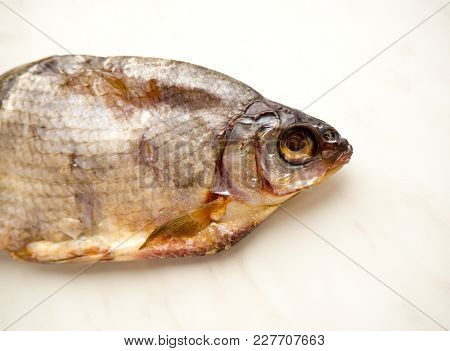 The Dried Fish Bream on a color background.