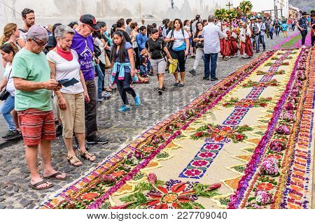 Antigua, Guatemala -  April 13, 2017: Dyed Sawdust & Flower Holy Thursday Procession Carpets In Town
