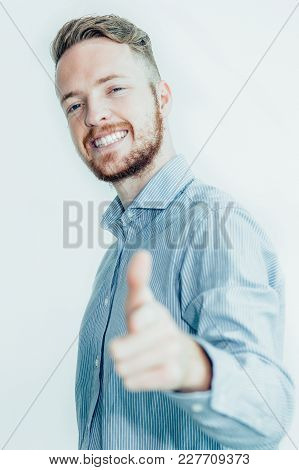 Closeup Portrait Of Joyful Young Man Looking At Camera And Pointing At Viewer. Isolated View On Whit