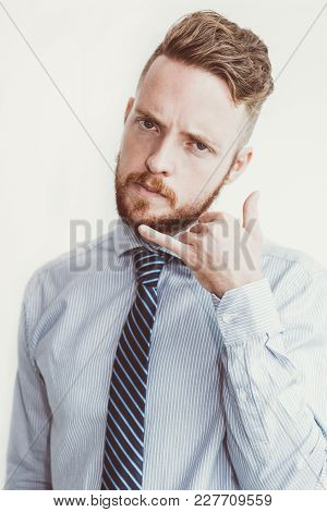 Closeup Portrait Of Content Young Business Man Looking At Camera And Making Call Me Gesture. Isolate