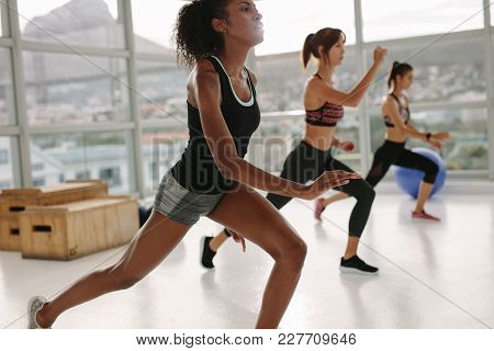 Women Doing Intense Workout In The Gym