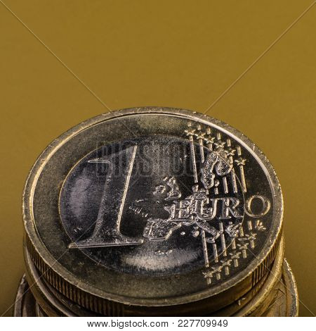 Stack Of Coins Is One Euro. Euro Money. Dark Background. Currency Of The European Union.