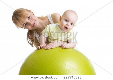 Young Mom Doing Exercises On A Fit Ball With Baby.