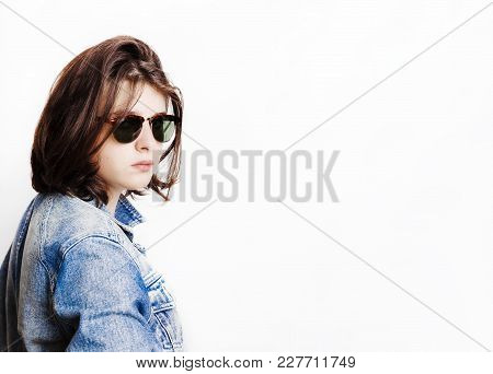 Stylish Handsome Young Man, Wearing Sunglasses, Posing On Jeans Jacket. Studio Shot On White Backgro