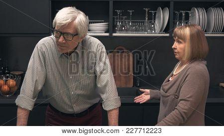 Senior Couple Quarreling In The Kitchen Interior