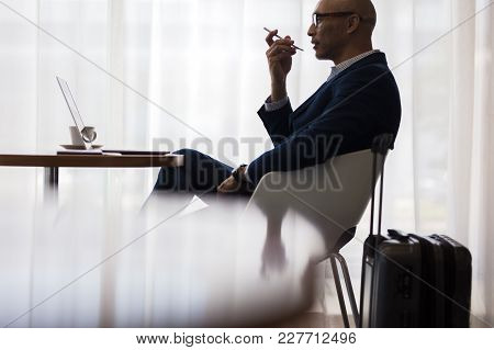 Two People Meeting In Office Cafe. Business Partners Sitting At Cafe Table In Modern Office.