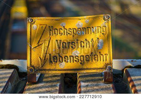 Sign: Hochspannung, Vorsicht! Lebensgefahr (german For: High Voltage, Caution! Risk Of Death), With