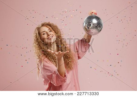 Closeup Of Beautiful Smiling Young Woman With Sparkles In Hair And On Face Posing Near Disco Ball Ov