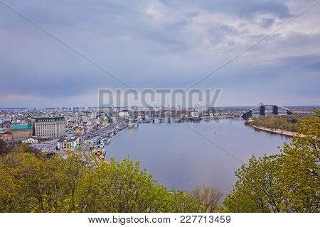 Kiev City In Ukraine Beside The Rive With Reflection In Water