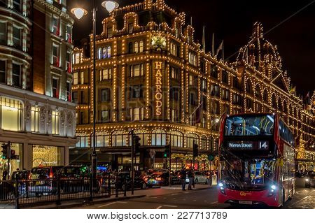 London, England - November 29, 2017: Night View With Red Double Decker Bus On Moving In Front Of Har