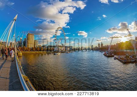 London, England - November 28, 2017: View With Famous London Eye And Big Ben From Golden Jubilee Bri