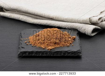 Colorful And Crisp Image Of Carob Powder With Linen Cloth On Shale