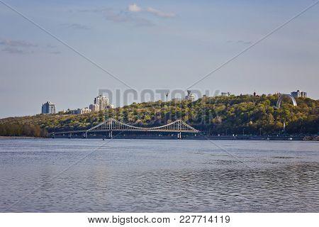The Pedestrian Bridge Across The Dnieper River In Kiev, The Capital Of Ukraine