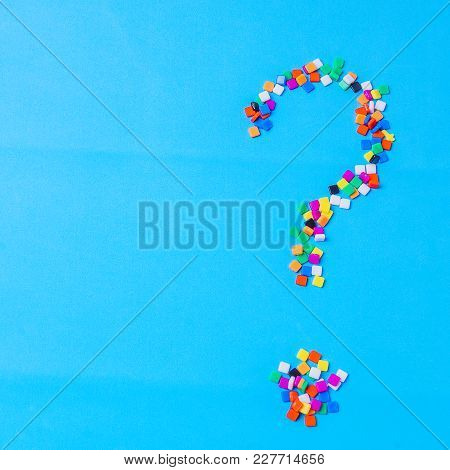 Multi Colored Fugure Question Mark On Bright Blue Background.