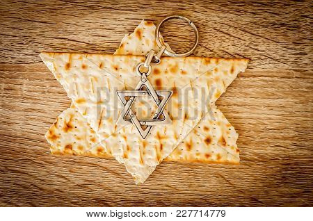 Two Pieces Of Matzah Make Up A Jewish Star Of David (