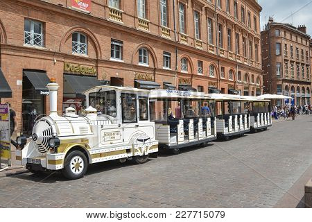 Toulouse, France - July 23, 2016: Tourist White Train Waiting For Tourists To Depart At The Centre O