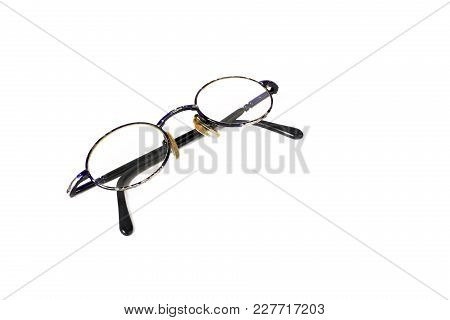 Science And Education - Old Glasses On A White Background.