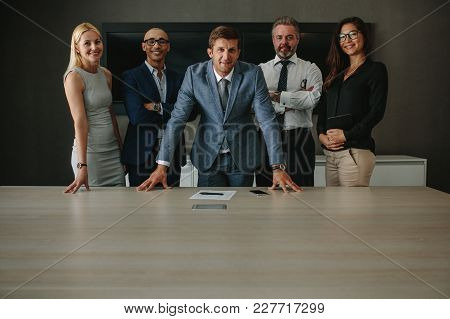 Business People Having A Project Discussion. Team Of Corporate Professionals Having Discussion In A