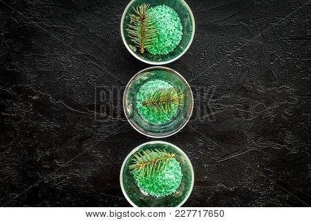 Spa Cosmetics. Green Spa Salt With Pine Scent On Black Background Top View.