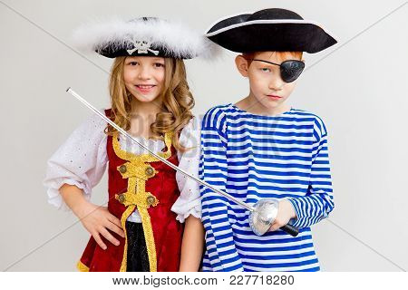A Portrait Of Two Kids In A Pirate Costume