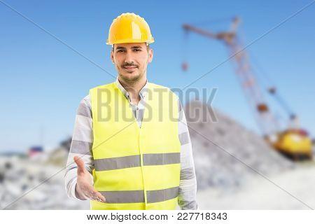 Friendly Foreman Or Engineer Giving Offering Handshake As Deal Gesture.
