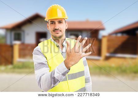 Handsome Smiling Architect Or Enginer Showing Number Five.