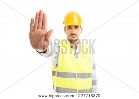 Engineer Or Architect Showing Palm As Stop Stay Gesture Sign.