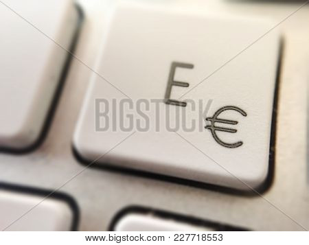 Close-up View Of Of The Button Of A Computer Keyboard With The Letter E And The Symbol Of The Euro C