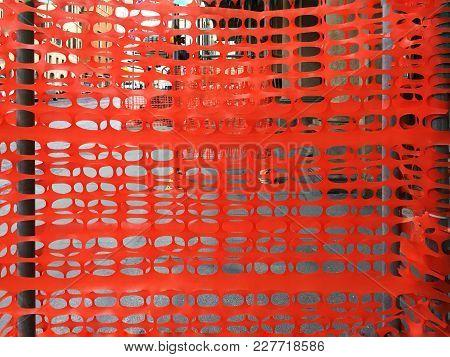 Plastic Orange Fence In A Construction Site