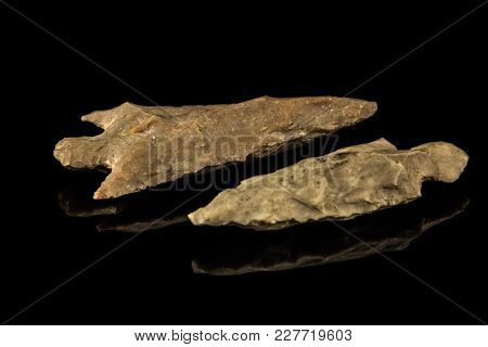 Two Old Indian Stone Arrowheads And Black Background