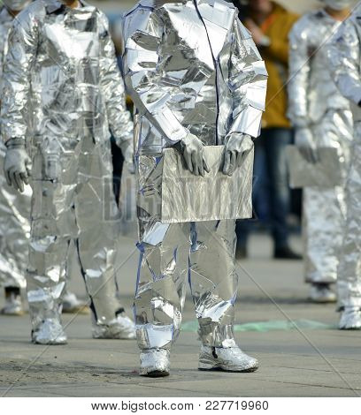 Unrecognizable Man Wrapped With Aluminium Foil, Holding Book, Image