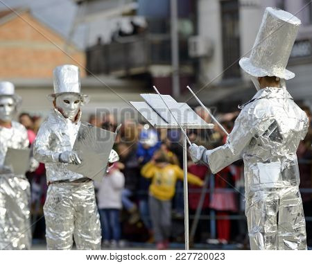 Unrecognizable Man Wrapped With Aluminium Foil, Conductor