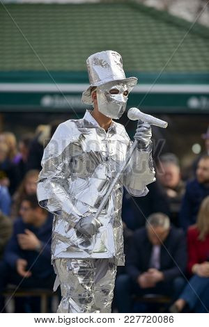 Unrecognizable Man Wrapped With Aluminium Foil, Singer