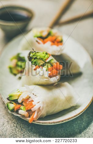 Shrimp And Vegetable Rice Paper Spring Rolls With Sauce On Ceramic Plate Over Grey Background, Selec