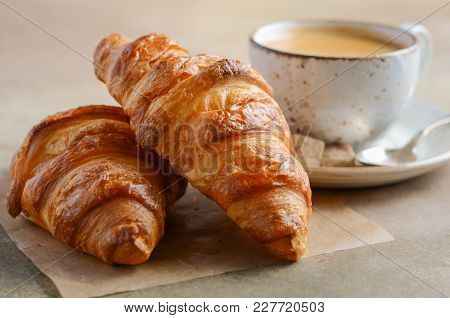 Cup Of Fresh Coffee With Croissant On Concrete Background, Selective Focus